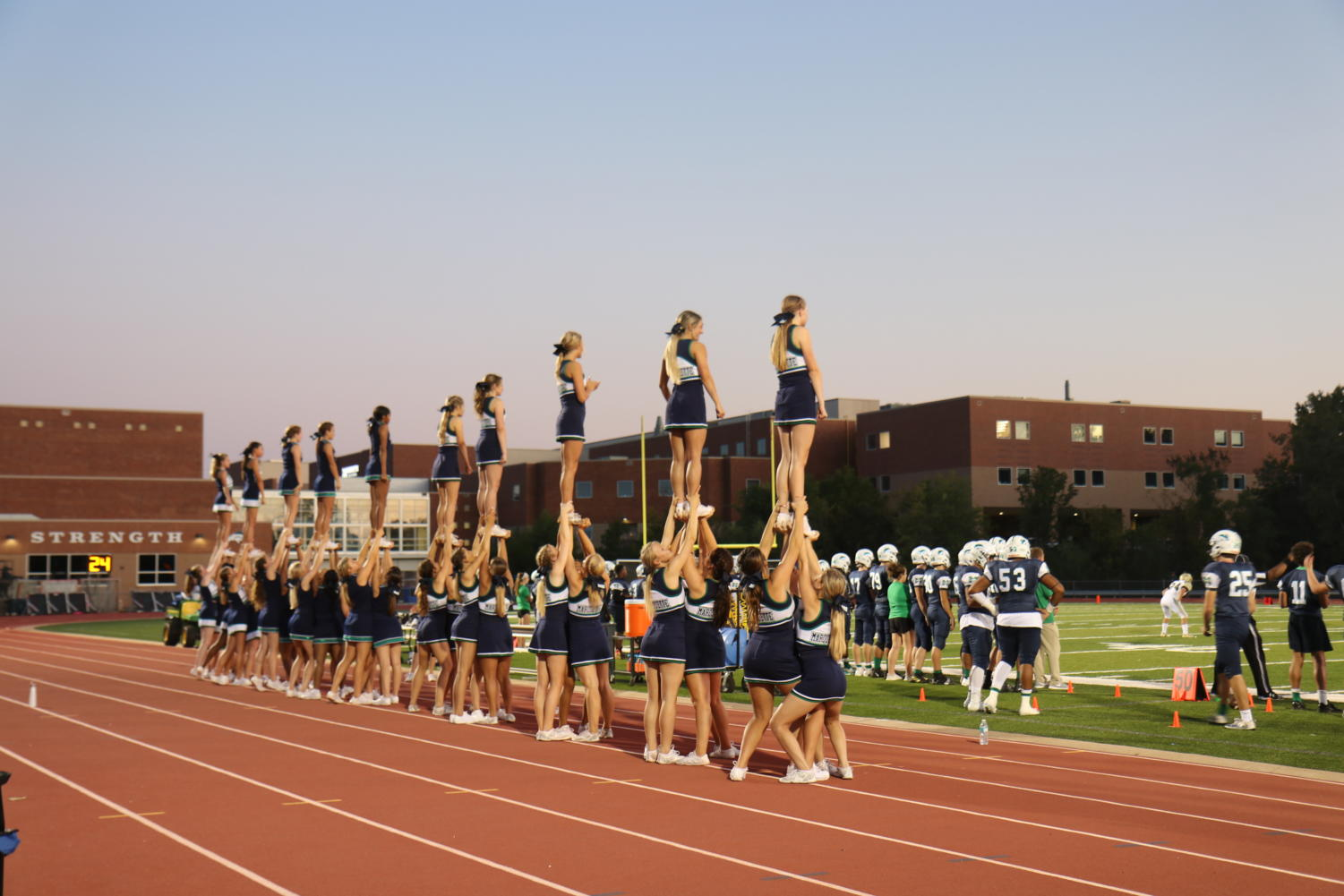 The+Mustangs+played+the+Lindbergh+Flyers+at+the+annual+Homecoming+game+Sept.+27+where+cheerleaders+performed+at+the+start+of+the+game.+Varsity+cheer+plans+to+compete+at+Regionals+Oct.+26.+