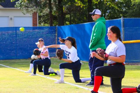 Mackenzie Gareau, senior, throws a softball at practice.