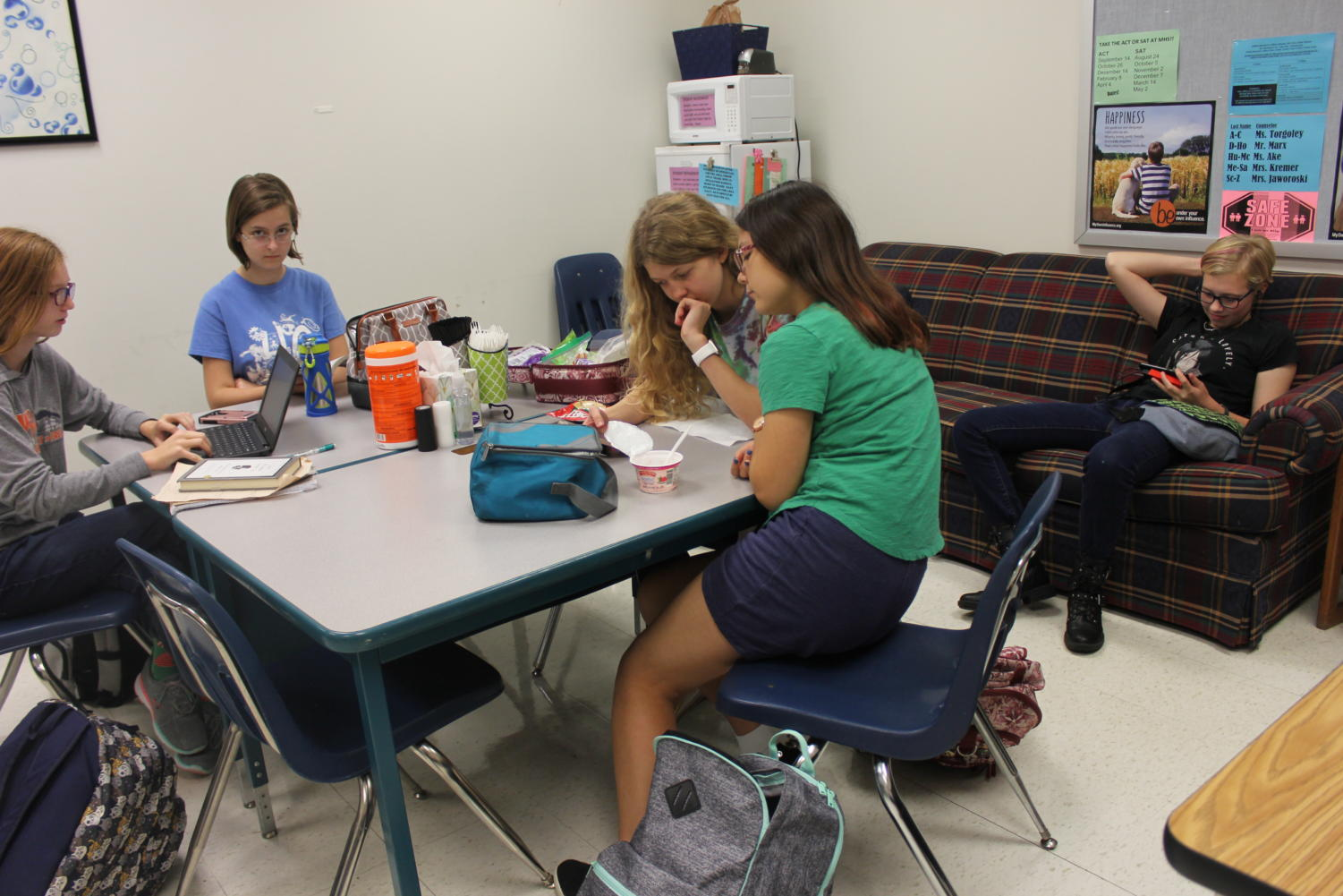 Mia Kreissler, junior; Lauren King, sophomore; and Ginger Ramirez, sophomore, eat lunch and read in the Gifted Room.