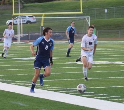 Jake Embleton, junior, drives the ball down field in a match against De Smet Jesuit.