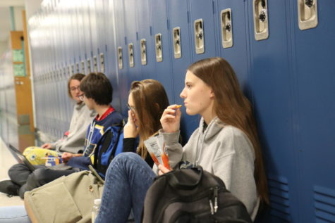 Mayce McEvoy, junior, eats lunch with her friends in the hall during Flex Time Friday. She was 1 of more than 1,500 students who signed a student-created petition following rumors of possibly taking away A Day Flex Time next semester. Following multiple discussions, the administration decided to keep Flex Time the same this semester and only adjusting C Days next semester.