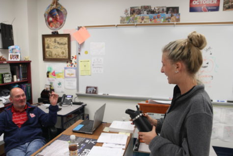 Katherine Andrews, senior, talks to Matthew Del Pizzo, social studies teacher, during Flex Time about her girls tennis match. Following recent state legislature, Flex Time has set schools behind on the required 1,044 credit minutes. To solve the problem, high school principals are meeting to discuss possibly scheduling a few Friday A Days without Flex Time.
