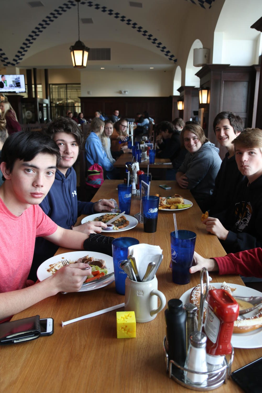 Junior+Tyler+Ray+and+sophomores+Kelton+Pumi%2C+Eric+Biever+and+Blake+Geisler+enjoy+their+German+lunches+at+the+Hofbrauhaus.+%E2%80%9CI+thought+the+food+was+really+good+because+of+its+authenticity%2C+and+we+don%E2%80%99t+taste+anything+else+like+it+in+St.+Louis%2C%E2%80%9D+Ray+said.+