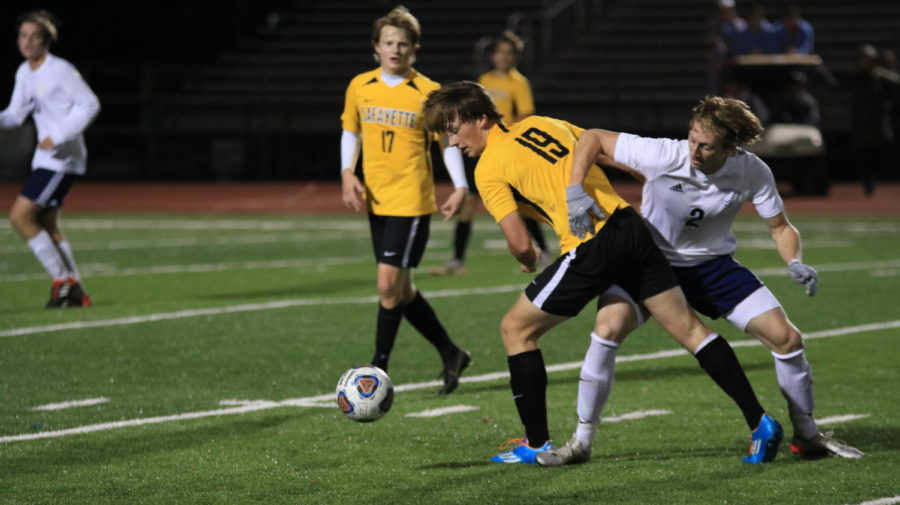"""Senior Ian Lynch, forward, and junior James Reynolds, defender, entangle as they compete for possession. The Mustangs were down by one goal late in the second half, but Lynch said he tried to remain positive and help his team no matter what happened in the game. """"I always look ahead and just keep fighting even if the score is down,"""" Lynch said."""