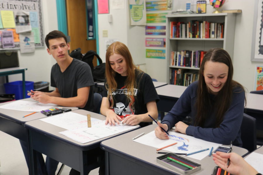 "M4MH members left to right are senior Zach Streicher, junior Laura Dorris, and senior Annie Getts. Club members took additional time outside of Flex meetings to design inspirational posters to be displayed in bathroom stalls this month. The students spent time playing music, coloring their posters, and enjoying each other's company. ""So far our meetings have been very educational, and this is much more interactive for everyone,"