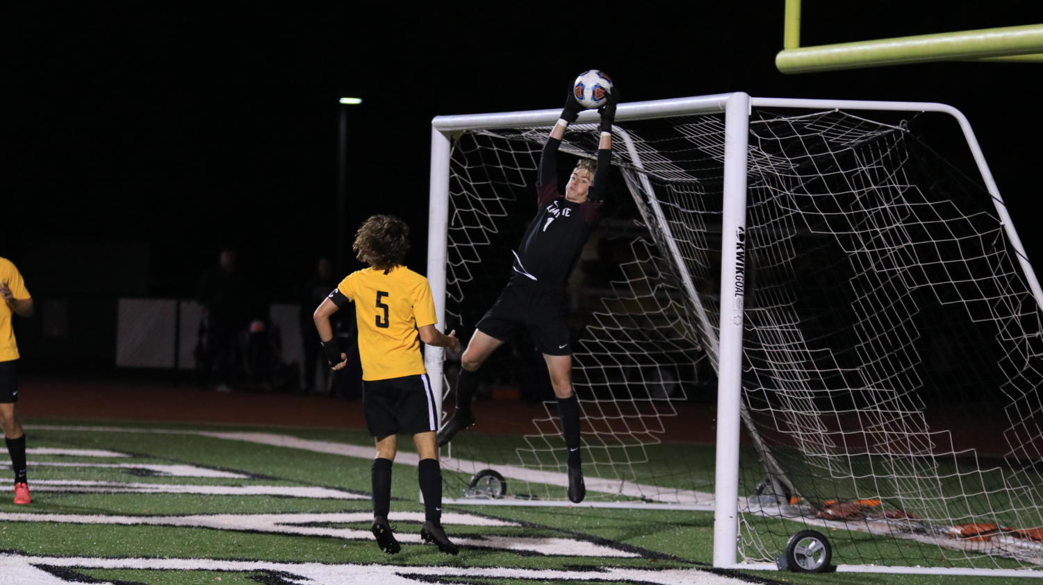 Senior+Carson+Campbell%2C+goalie%2C+leaps+into+the+air+to+catch+a+high+center+shot.+Campbell+played+without+substitution+for+80+minutes.++%0A