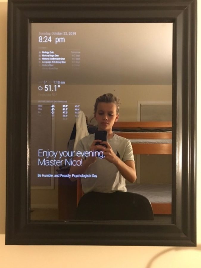 Nico Case, freshman, takes a picture of his schedule on his smart mirror. Case constructed the mirror over three weeks in the summer on his own.