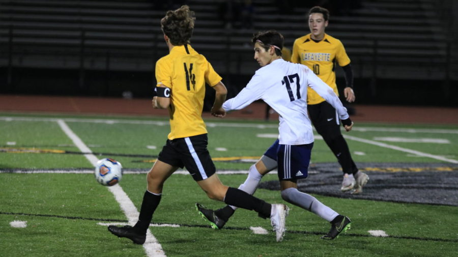 Senior Sriram Zassenhous, defender, weaves through center field to push the ball upfield. Zassenhous was knocked over several times over the course of the game after making aggressive plays.