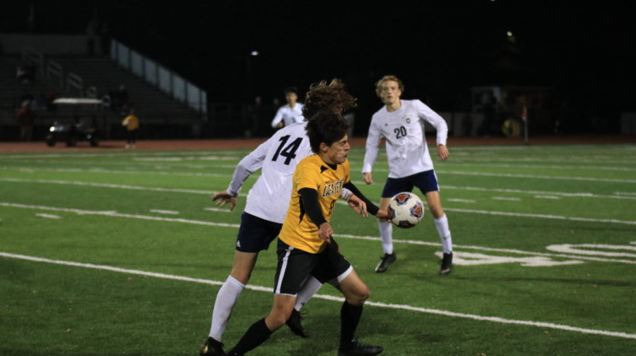 Sophomore Almedin Muratovic, midfielder, slams into the back of senior Lucas Nickerson, forward, following another goal by Lafayette, making the score 2-0.