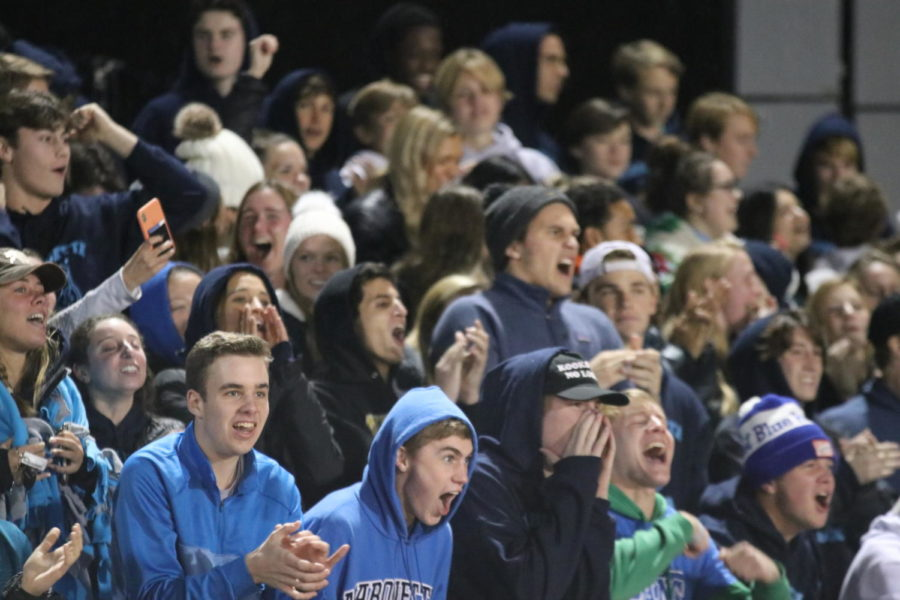 Fans cheer after MHS scores in the second half. After several missed opportunities by the Mustangs, senior Sam Weis, defender, shot the ball into the goal off of a corner kick, making the score 2-1.