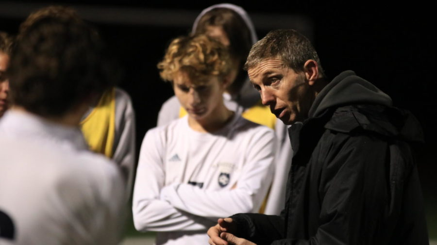 """Chris Kenny, varsity boys soccer head coach, addresses his team after a 2-1 loss. Kenny encouraged the underclassmen to learn from this season, while also thanking the seniors for their contributions to the team. """"We didnt finish the chances we had,"""" Kenny said. """"But I was proud of them, the way they played in the second half."""""""