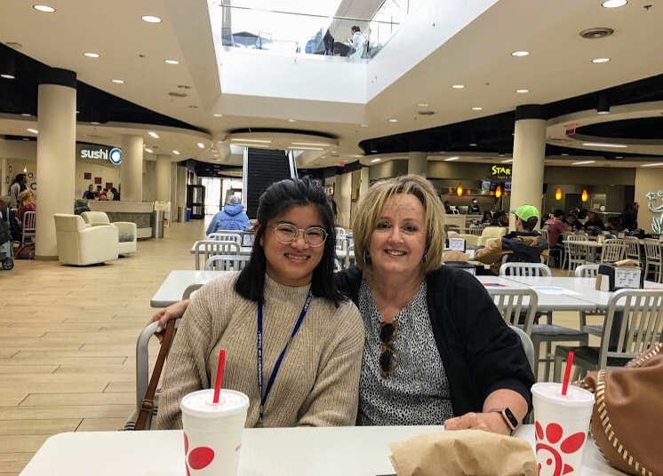 "Madison Fischer, senior, enjoys a meal from Chick-fil-a at the mall with her mother. ""Being adopted has given me more perspective on being a foreigner and a minority in America and how lucky I am compared to many immigrants that never get a chance to come to America legally,"" Fischer said. Photo used with the permission of Madison Fischer."