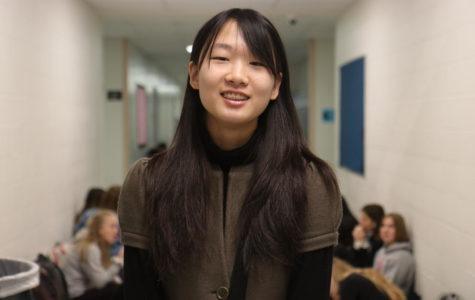 Eunice Heo, junior, eats Korean food with her family.