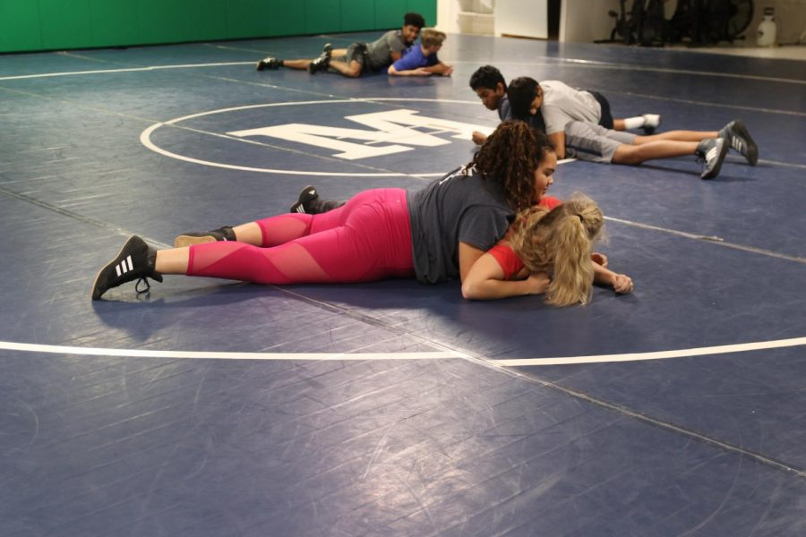 Alyssa+Washington%2C+freshman%2C+holds+Lindsey+Steltzer%2C+junior%2C+in+a+wrestling+hold.+Both+girls+are+experiencing+their+first+seasons+on+the+team.