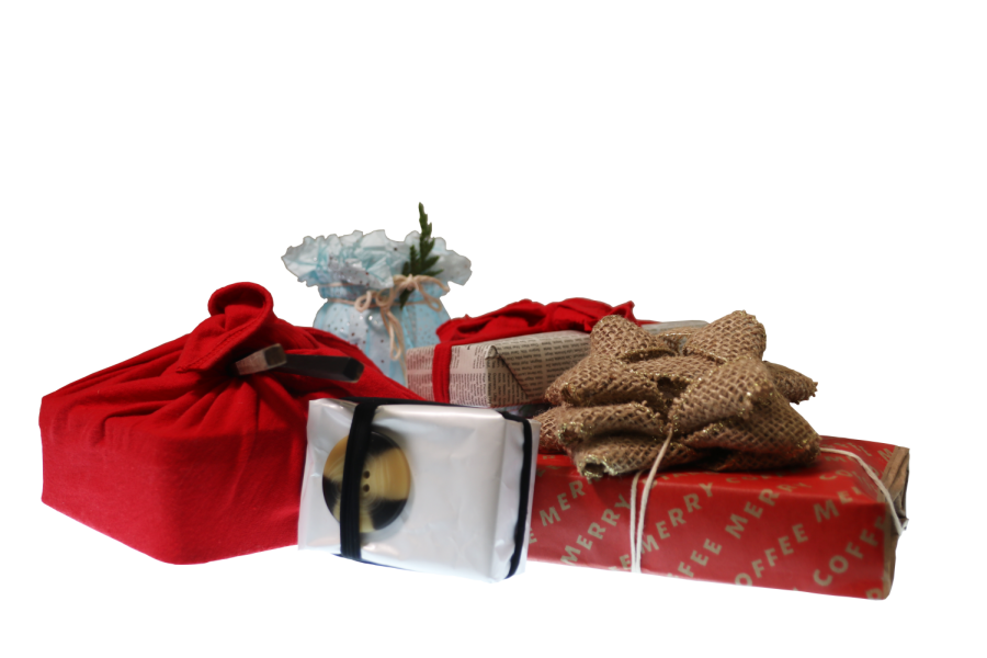 Four of the nine gift wrapping alternatives are presented. Each item only required items from around the house such as a old t-shirt, a potato chip bag, a newspaper page and chopsticks.
