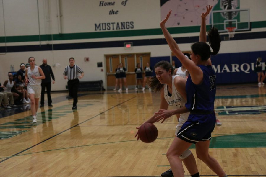 Ally Fitzgerald, sophomore, drives to the basket against Grace Claney, Junior, of Ladue, Thursday, January 24. Fitzgerald put up 10 points, 3 rebounds, 2 assists and 6 blocks in the 78-61 loss.