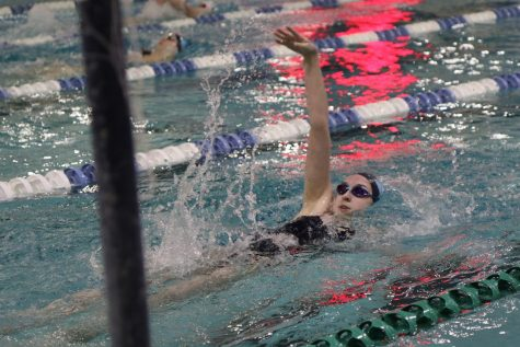 Jenna Howard, junior, swims in the 200 individual Medley in her match against Eureka, January 13. She would finish third of eight and help the team win 127-59.