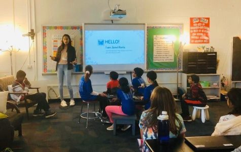 """Janvi Huria, junior, introduces herself to a classroom full of fifth graders. Each unit, Huria comes in for a week to teach fifth graders about additional topics outside their curriculum. """"I hope the kids learn not only can you make a career just by asking questions but hopefully they can find something they're passionate about that can last a long time,"""" Huria said."""