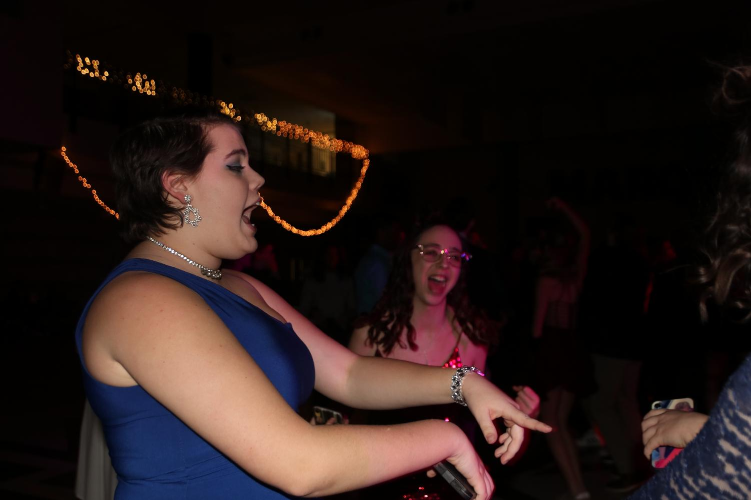 Surrounded+by+her+friends%2C+Carrie+Lunte%2C+sophomore%2C+dances+to+%E2%80%9CMagic%E2%80%9D+by+B.o.B.+Lunte+attended+the+dance+last+year+as+well.+%E2%80%9CI+kind+of+wish+there+were+more+people%2C+but+it%E2%80%99s+pretty+good+to+hang+out+with+friends%2C%E2%80%9D+Lunte+said.+