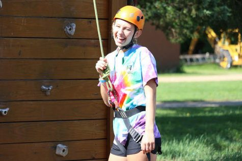 Katie Curran, senior, prepares to go rock climbing at YMCA Camp Lakewood in Pelosi, Mo. She attended the camp for four years in the East camp program for teens ages 13-17.
