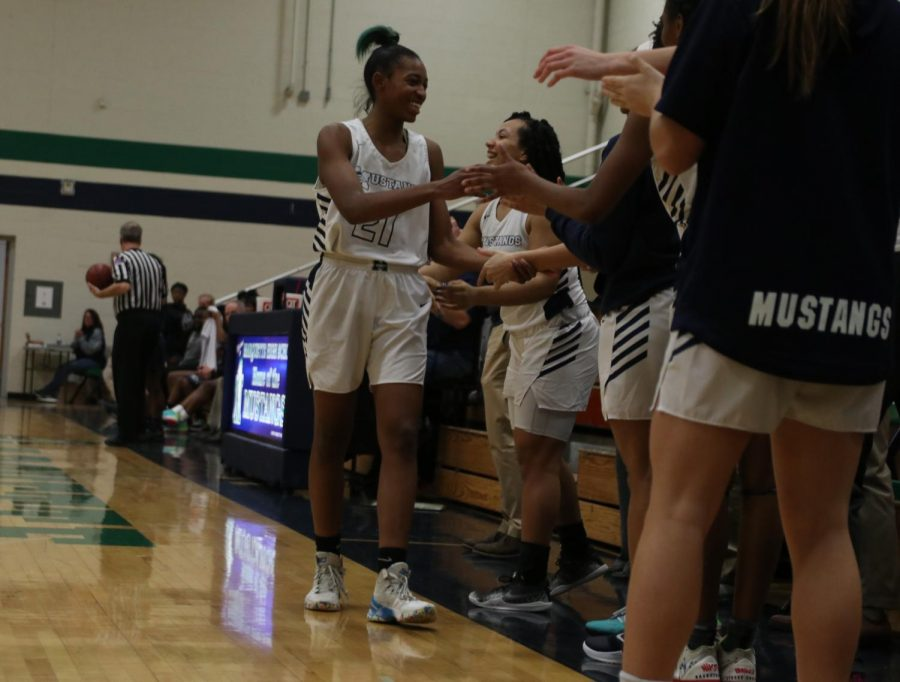 "With little time left in the game, Love Troupe, Senior, is called out of the game to get her final applause. ""It's bittersweet, but I'm glad I was able to have the career I had,"" Troupe said. Troupe scored 7 points on 5 shots and had 4 defensive rebounds in that game."