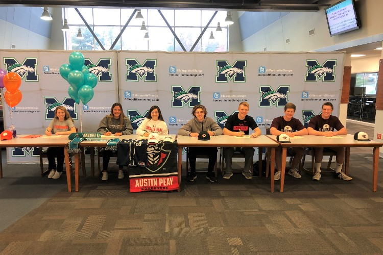 Seniors+announced+their+commitments+to+different+colleges+on+the+first+national+signing+day+of+the+year%2C+Nov.+23.+Four+incoming+athletes+signed+to+state+schools+and+three+signed+to+junior+colleges.