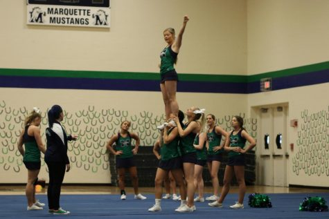 "Abbey Gradle, varsity head coach, talks the team through a stunt at their Nationals Sendoff Showcase. The team holds a showcase for their routine each year before they leave for UCA Nationals in Orlando, and this year held it during Flex Time the day before they left. ""I enjoy having the Nationals Sendoff because it lets us run the dance full out for an audience before we leave,"" Scognamiglio said. ""It is good practice, and I enjoy showing our routine to other students and staff at Marquette."""