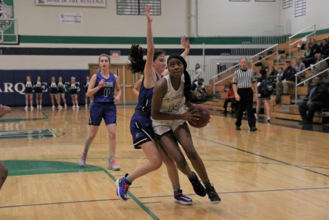 Kennedi Watkins, junior, drives to the basket against a defender. Watkins scored 27 points in the loss to Ladue on January 22.
