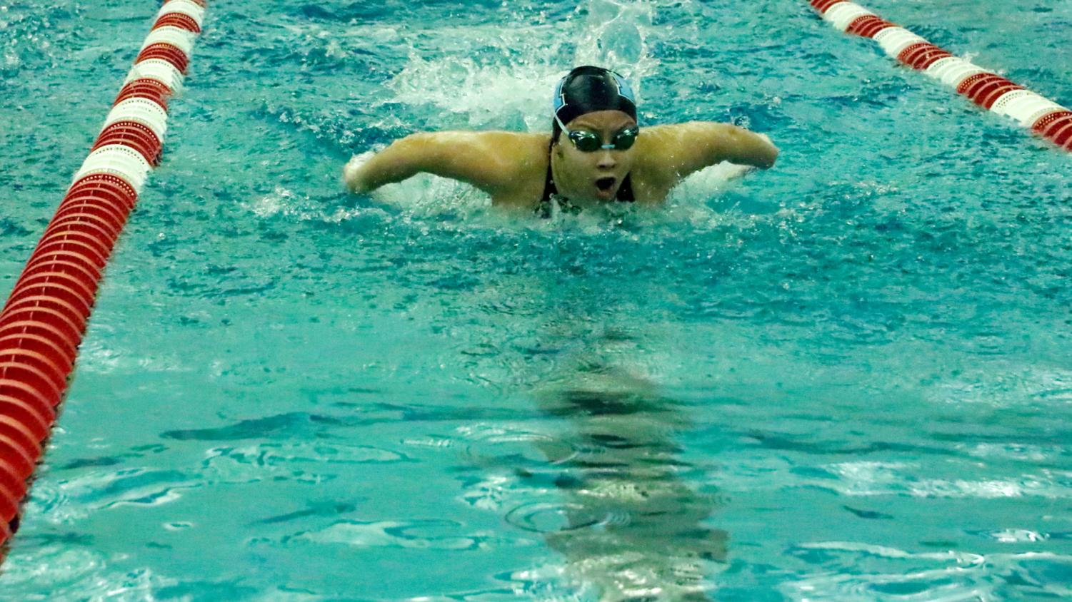 Amanda Yu, senior, pushes to finish strong during the last 50 meters of the 100 meter fly race during Conference finals at Kirkwood High School on Thursday, Feb. 6. Yu came in third, with Marquette going on to win the meet with a score of 441 points.