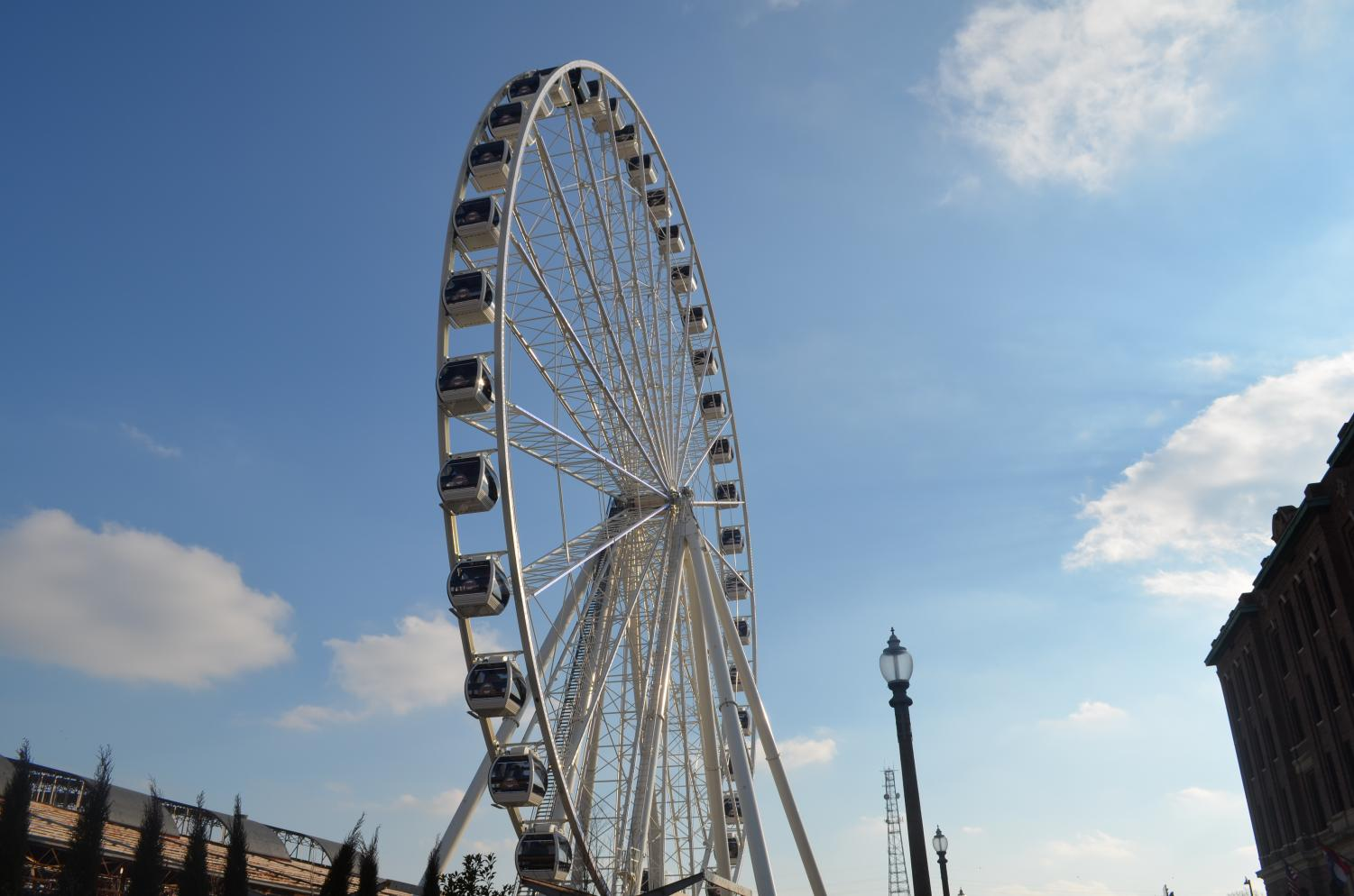 Tourists+enjoy+the+ride+on+the+200+ft+tall+attraction%2C+The+St.+Louis+Wheel.+The+wheel+takes+passengers+along+the+St.+Louis+skyline+during+the+15-minute+trip.+The+wheel+also+has+42+fully+enclosed+seats+that+are+climate+controlled+and+seat+up+to+six+adults+each.+