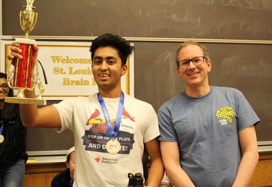 Sriharsha+Guduguntla%2C+junior%2C+presents+his+trophy+and+stands+with+Viktor+Hamburger+Professor+of+Biology+Dr.+Erik+Herzog%2C+an+organizer+of+the+St.+Louis+Area+Brain+Bee+at+Washington+University.+Guduguntla+said+he+will+be+working+alongside+Dr.+Herzog+in+his+internship+at+WashU+for+a+laboratory+research+topic+of+choice.+%22I%27m+definitely+interested+in+studying+neurodegenerative+disorders%2C+stem-cells+therapy%2C+cancer%2C+metabolism%2C+and+how+all+those+fields+interact%2C+which+is+the+coolest+part.%22