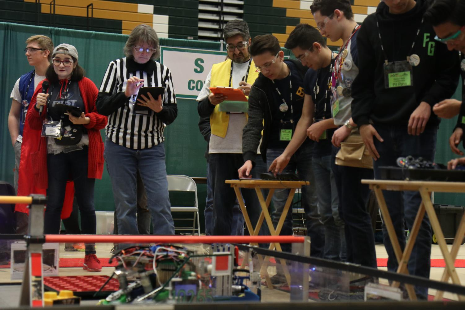 Baryons+members%2C+seniors+Adam+Cohen%2C+Shon+Sayfunddinov+and+Daniel+Vayman+prepare+the+robot+for+autonomous.+They+lost+the+match%2C+with+69-42+points.+Autonomous+is+the+period+when+the+robot+moves+by+itself+in+the+way+that+the+team+codes+it.+Sayfunddinov+drove+the+robot+because+it+is+a+tradition+for+seniors+to+drive.+%E2%80%9CI+think+driving+is+fun+and+interesting%2C%E2%80%9D+Sayfunddinov+said.+%E2%80%9CYou+definitely+feel+more+a+part+of+the+team+and+more+important.%E2%80%9D+