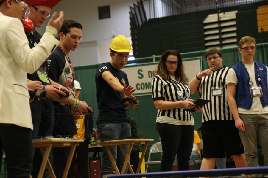 "Adam Cohen and Shon Sayfunddinov, Baryon members, compete in the quarterfinals with their alliance partners, The Red Hot Techie Peppers. They competed against the Luxons, whose alliance partners were the Robot Warriors. The Baryons' team won with the points being 80-53. Cohen has been in robotics since his freshman year and is now the head documenter. He thought that driving is one of the most fun parts of robotics. ""It's just really fun to go out there and compete with the other teams and see what people can do,"" Cohen said."