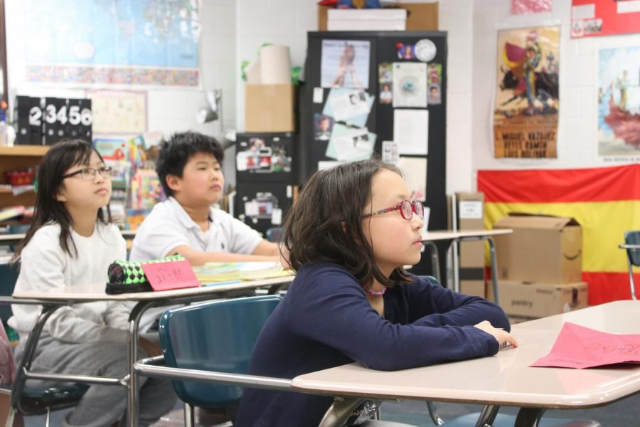 Children attend a simplified Chinese class at the St. Louis Chinese Language School at Selvidge Middle School. The teacher discussed the coronavirus, how easily it can spread and how a carrier does not have to show any symptoms to transmit it. Students raised $200 for Wuhan relief by donating spare change and their allowance.