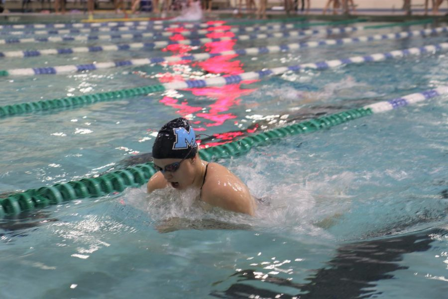 Abbey Bolt, senior, swims during a dual meet against the Eureka Wildcats. Marquette would win that meet 129-59, extending their undefeated regular season streak of six years.