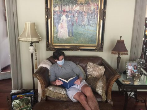 Christian Springer, sophomore, reads a book while social distancing in his house.