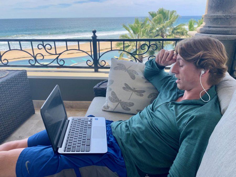 Ian Lynch, senior, studies for his online classes near Cerritos Beach in Todos Santos.