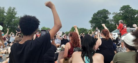 In a protest for George Floyd Wednesday, June 3, a large crowd sat in a moment of silence for 8 minutes and 46 seconds to resemble the duration of time former Minneapolis police officer, Derek Chauvin, knelt on Floyd