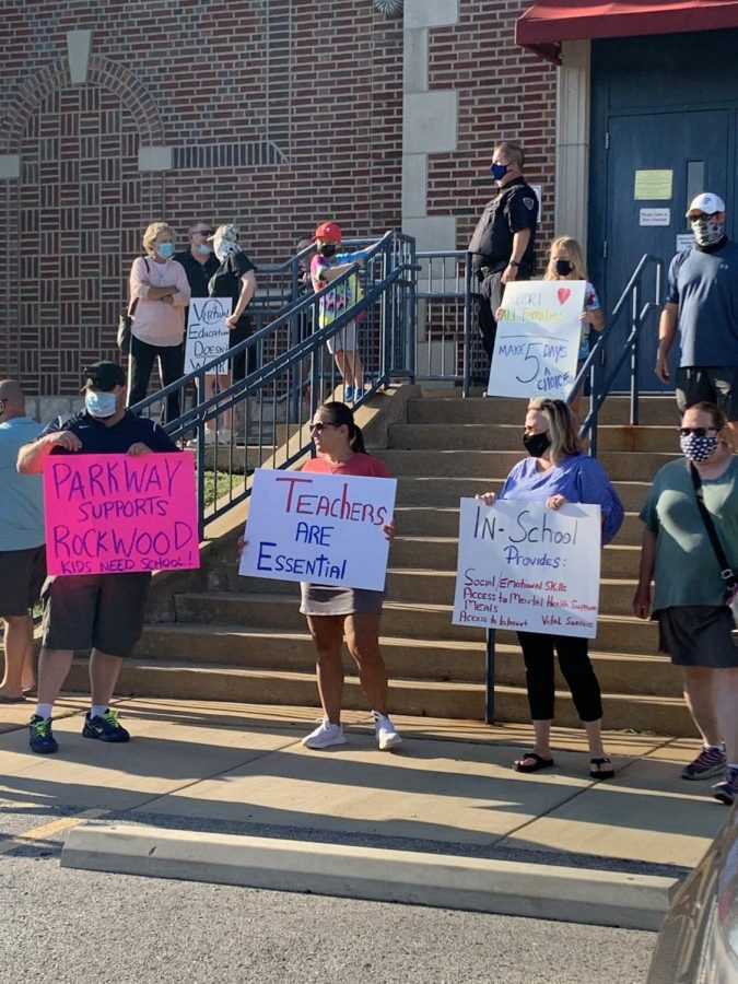 Members of the RSD community held up signs outside the Rockwood Administrative Annex in Eureka to protest not having a five-day in-school option.