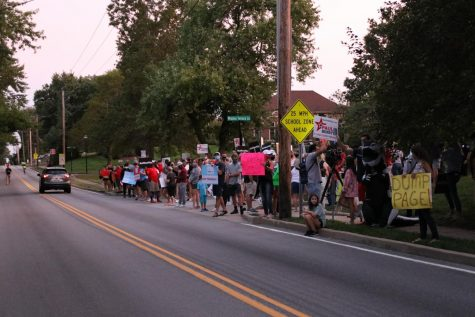 Protesters gather at the entrance of Windsor Terrace Lane and North Spoede Road as the sun sets. Protesters called for the restarting of all sports, the removal of deomocratic County Executive Dr. Sam Page from office, and the election of republican Paul Berry III in the fall.