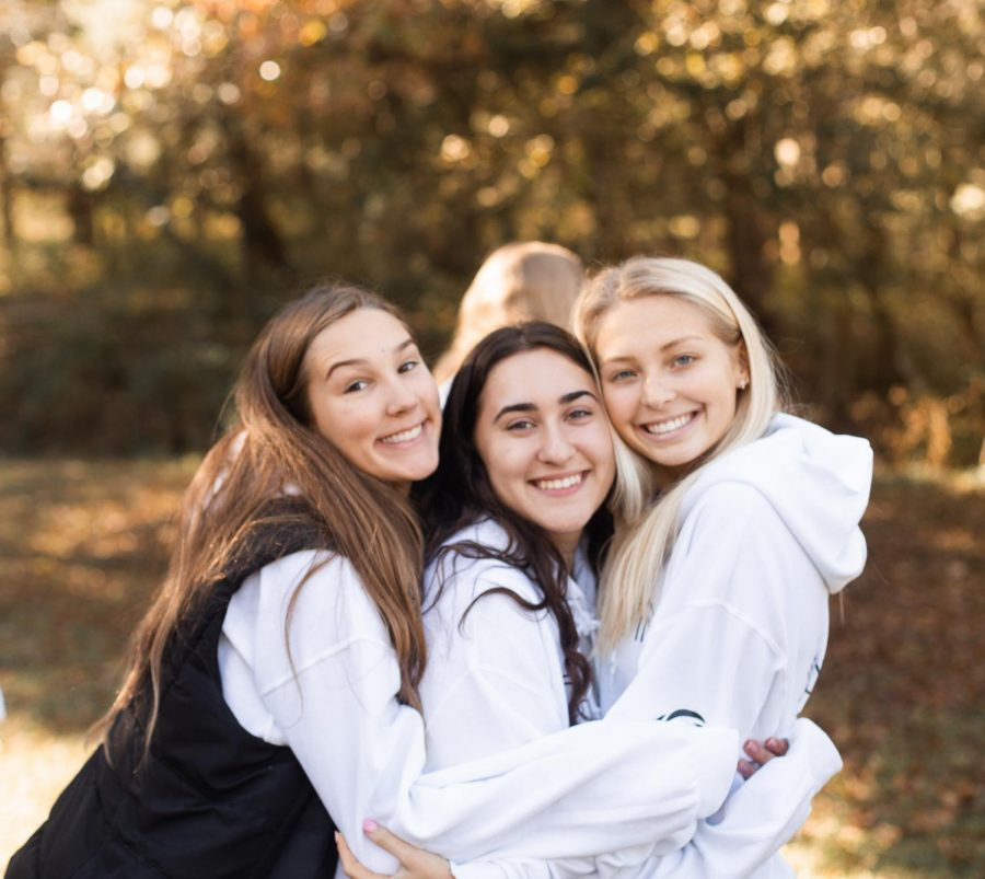 Sophia+Marciano+and+her+friends+pose+together+at+the+2019+Fall+Retreat+with+Holy+Infant+Youth+Ministry.+