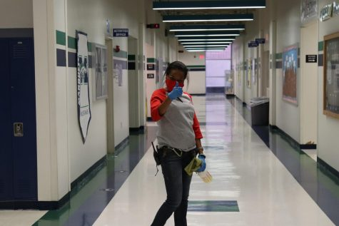 "Monique Johnson, custodian, continuously walks the school disinfecting areas of high contact. ""It is important that every one stays safe. Wear a mask and be mindful,"" she said."