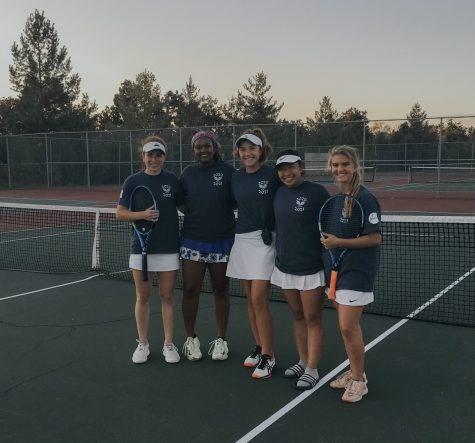 "Girls Tennis finishes their season with a win against the previously undefeated Timberland. ""This season was by far the most enjoyable of my time in high school despite the uncertainty and restrictions due to coronavirus,"" Phoebe Calabrese, senior and varsity player, said. ""All of our players wanted the best for one another, and we were each other's biggest supporters."""