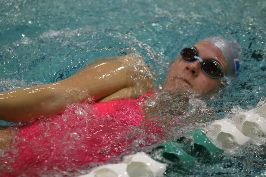 "Carsyn Cosman, junior, takes advantage of the pool access to improve during practice Friday, Dec. 11. Cosman said limited access to pools last spring and summer challenged her. ""I feel I am set back a little bit from last season,"" Cosman said."