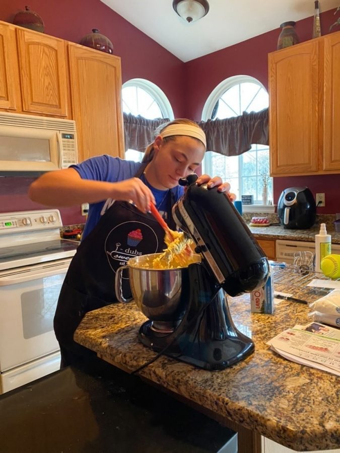 Junior Jess Willsey works to fill an order for a customer of her baking business J Dubs Sweets.