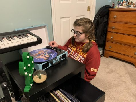 """Annika Haas, senior, listens to music and plays violin, along with other instruments, as a creative outlet for mental health. She turns to Spotify Music or her vinyl record player to find songs that represent and elevate her current mood. """"I have a lot of anxiety, so especially this year, music has really helped me understand that everything will be alright,"""" Haas said."""