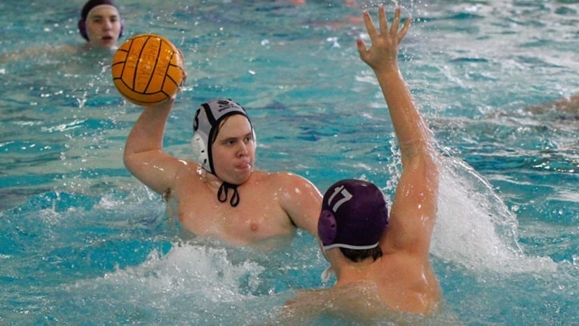 Luke Arens, senior, looks to see if he has a shot on goal during a water polo game against Parkway North last school year. MHS won with a final score of 15-8.
