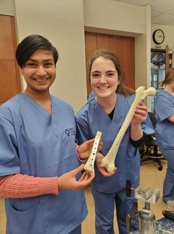 Senior Amanda Eshelman [Anisha Jarang on the left] participated in Perry Initiative Program at WashU in which they hosted a series of events encouraging girls to pursue careers in Orthopedic Medicine and Engineering which is a profession that is only 6% women. Eshelman said this program inspires her to combine her interest in healthcare and computer science. She said was amazed at the process of using technology in orthopedic surgery to place screws and visualize joint replacements.