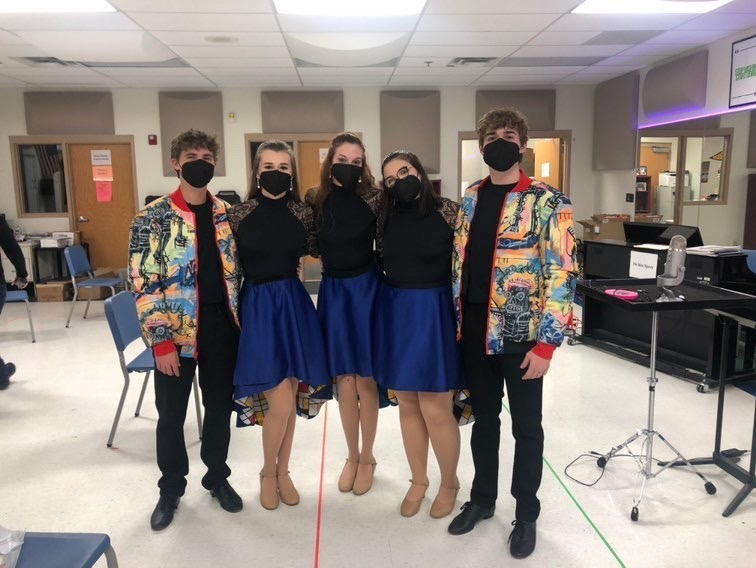 Seniors Andrew Messina, Cassidy Barger, Jenna Howard, Paige Hanson and Mason Barkofske get ready in their costumes for one of their last show choir performances for Center Stage.