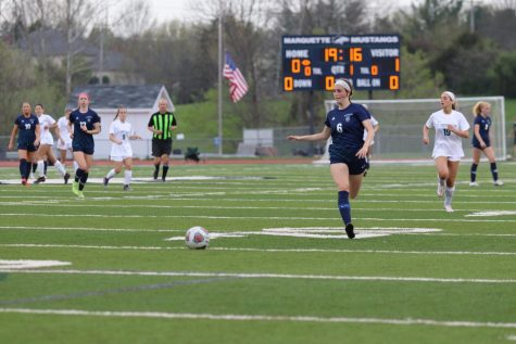 Senior Reece Merifield, midfielder, chases down a ball in the Mustangs end with little pressure.